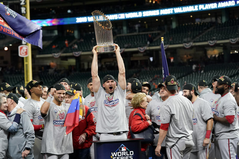 CORRECTS ID TO FIRST BASEMAN RYAN ZIMMERMAN, NOT CATCHER YAN GOMES - Washington Nationals first baseman Ryan Zimmerman celebrates with the trophy after Game 7 of the baseball World Series against the Houston Astros, Wednesday, Oct. 30, 2019, in Houston. The Nationals won 6-2 to win the series. (AP Photo/David J. Phillip)
