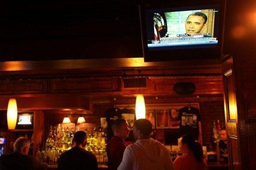 Patrons of New York gay bar the Stonewall Inn watch a news report as Barack Obama became the first US president to say publicly he was in favor of same-sex marriage, in a high-stakes intervention in a pre-election debate roiling American politics