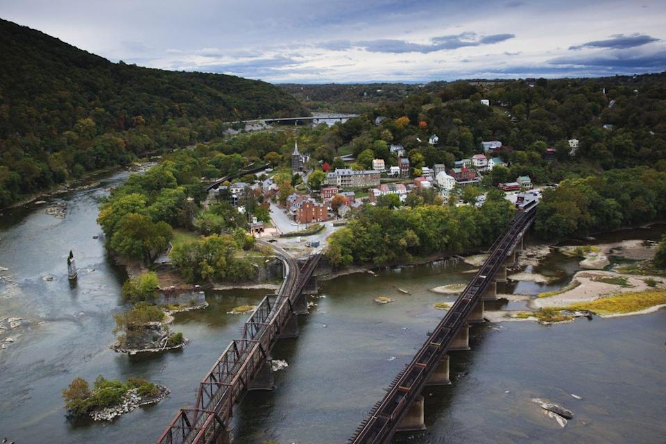 "<p>This <a href=""https://www.tripadvisor.com/Tourism-g60722-Harpers_Ferry_West_Virginia-Vacations.html"" rel=""nofollow noopener"" target=""_blank"" data-ylk=""slk:tiny town"" class=""link rapid-noclick-resp"">tiny town</a> is located on the Shannendoah River and the ideal getaway for nature lovers. There are eight (yes, eight) national parks and heritage sites to visit in the area. </p>"