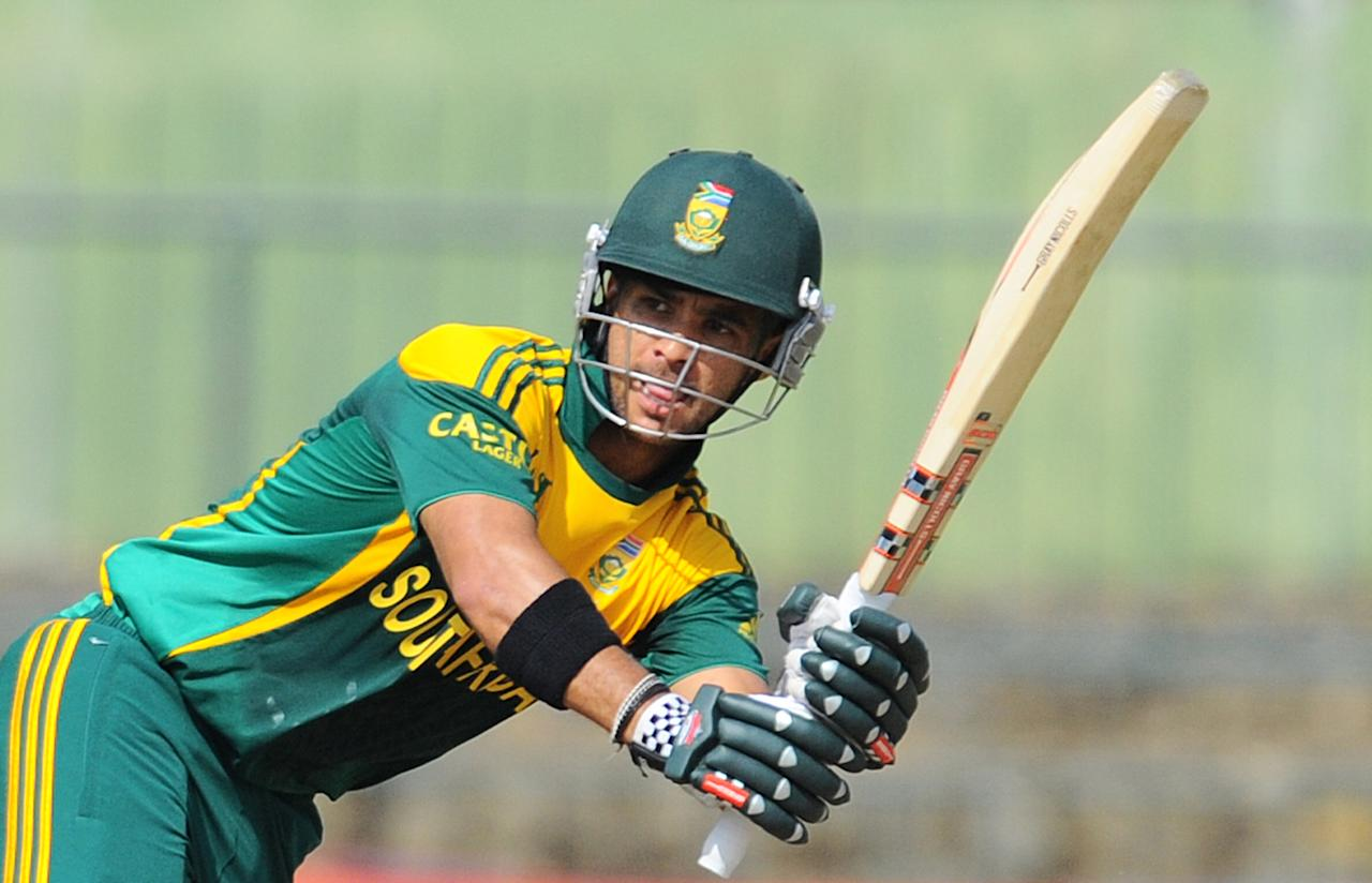 South African batsman Jean-Paul Duminy plays a shot during the fourth One Day International (ODI) cricket match between Sri Lanka and South Africa at the Pallekele International Cricket Stadium in Pallekele on July 28, 2013. AFP PHOTO/ Ishara S.KODIKARA