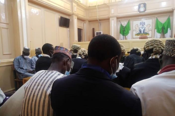 People are seen seated inside a court during a hearing of an appeal case in a blasphemy case in Kano