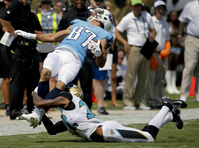 <p>Tennessee Titans wide receiver Eric Decker (87) is tackled by Jacksonville Jaguars cornerback Aaron Colvin after a reception during the first half of an NFL football game, Sunday, Sept. 17, 2017, in Jacksonville, Fla. (AP Photo/Stephen B. Morton) </p>