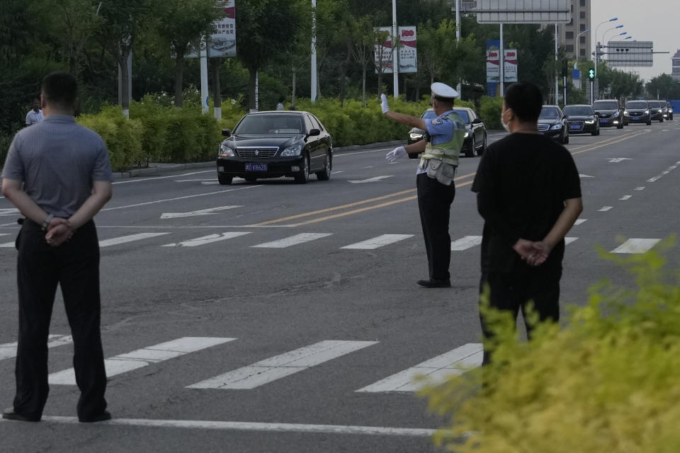 """A car with a sign which reads """"Special transport for Foreign Affairs Reception"""" is seen ahead of a convoy of cars that is believed to include U.S. deputy secretary Wendy Sherman as they prepare to enter the Tianjin Binhai No. 1 Hotel where U.S. and Chinese officials are expected to meet in Tianjin municipality in China on Sunday, July 25, 2021. Deputy Secretary of State Wendy Sherman travelled to China this weekend on a visit that comes as tensions between Washington and Beijing soar on multiple fronts, the State Department said Wednesday. (AP Photo/Ng Han Guan)"""