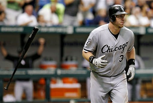 Chicago White Sox's Adam Dunn flips his bat as he follows the flight of his sixth-inning, two-run home run off Tampa Bay Rays starting pitcher Matt Moore during a baseball game, Monday, May 28, 2012, in St. Petersburg, Fla. (AP Photo/Chris O'Meara)