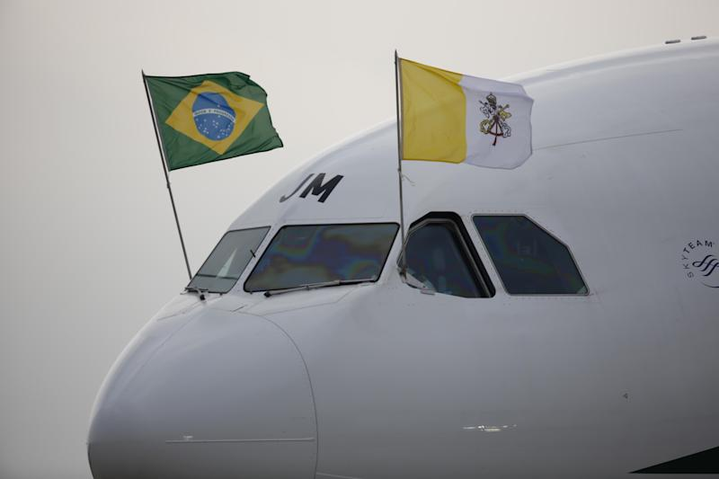 Pope Francis' plane arrives at the international airport in Rio de Janeiro, Brazil, Monday, July 22, 2013, in his first trip as pontiff to Latin America. Pope Francis, the 76-year-old Argentine who became the church's first pontiff from the Americas in March, returns to the embrace of Latin America to preside over the Roman Catholic Church's World Youth Day festival. (AP Photo/Jorge Saenz)