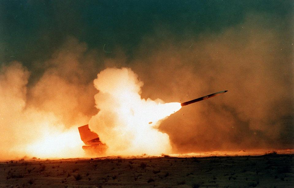 A Multiple Launch Rocket System, firing in the Saudi Desert, by 2nd Field Artillery, during the Gulf war (Mike Moore/PA)