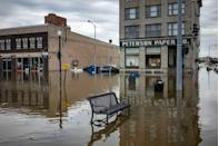 <p>Flood water surrounds a bench near the main breach in the Mississippi River in Davenport, Iowa on Friday, May 3, 2018.</p>