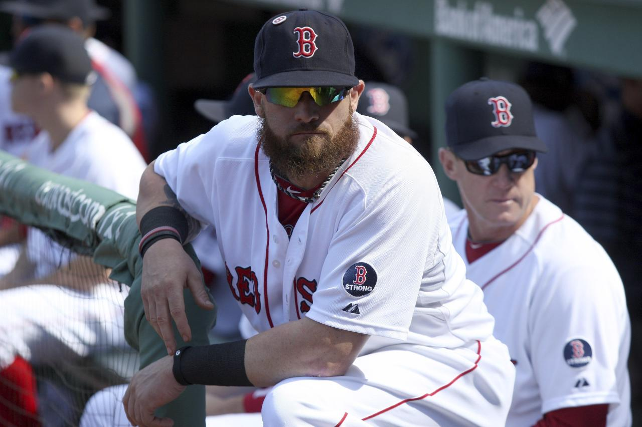 Boston Red Sox Jonny Gomes prepares in the dugout before facing the Toronto Blue Jays in their MLB American League East baseball game in Boston, Massachusetts, September 22, 2013. REUTERS/Dominick Reuter (UNITED STATES - Tags: SPORT BASEBALL)