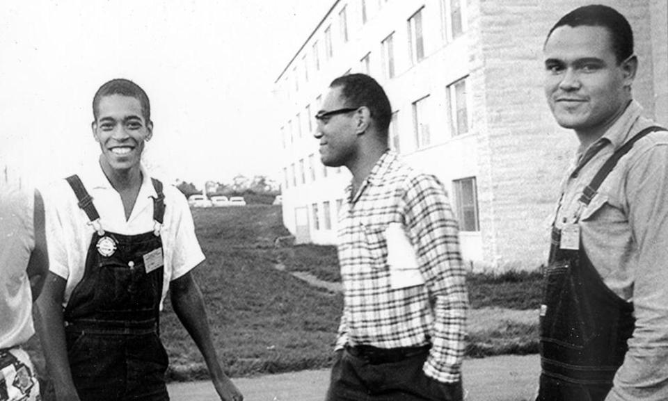 Bob Moses, centre, with fellow activists Hollis Watkins, left, and Lawrence Guyot at the National Student Association conference in Bloomington, Indiana in 1963.
