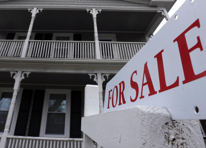 In this Tuesday, March 5, 2013, photo, a for sale sign hangs in front of a house in Plymouth, Mass. Sales of previously occupied U.S. homes dipped in March as the supply remained tight.  (AP Photo/Steven Senne)
