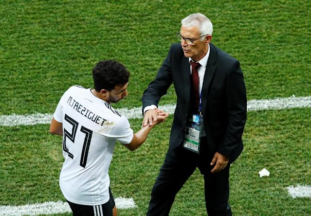 Soccer Football - World Cup - Group A - Saudi Arabia vs Egypt - Volgograd Arena, Volgograd, Russia - June 25, 2018 Egypt's Trezeguet shakes hands with coach Hector Cuper after he was substituted REUTERS/Jason Cairnduff