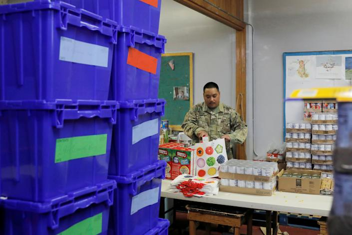 P.F.C. Sison of the New York Army National Guard helps pack pantry bags for food distribution with Hope Community Services in an area with multiple cases of coronavirus disease (COVID-19) in New Rochelle, New York, U.S., March 18, 2020. (Andrew Kelly/Reuters)