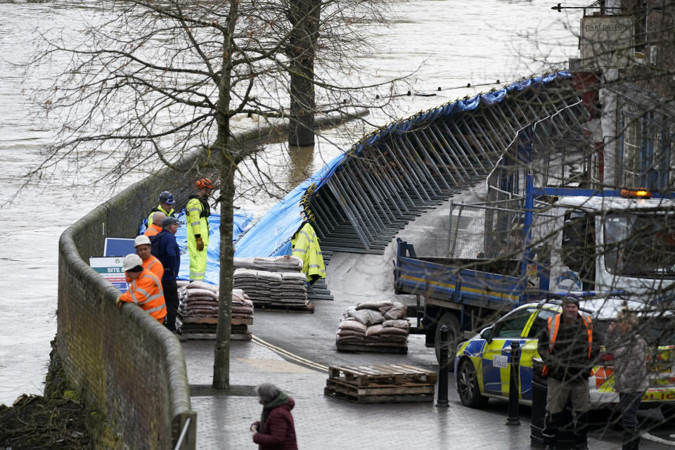 IRONBRIDGE,  - FEBRUARY 18: Flood barriers are erected on the banks of the River Seven following Storm Dennis on February 17, 2020 in Ironbridge, England. Storm Dennis is the second named storm to bring extreme weather in a week and follows in the aftermath of Storm Ciara. Although water is residing in many places flood warnings are still in place. (Photo by Christopher Furlong/Getty Images)