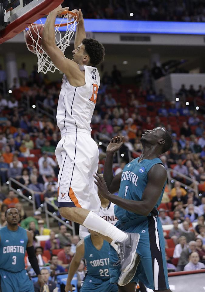 Virginia forward Anthony Gill (13) shoots on Coastal Carolina center El Hadji Ndieguene (11) during the second half of an NCAA college basketball second-round tournament game, Friday, March 21, 2014, in Raleigh. (AP Photo/Chuck Burton)
