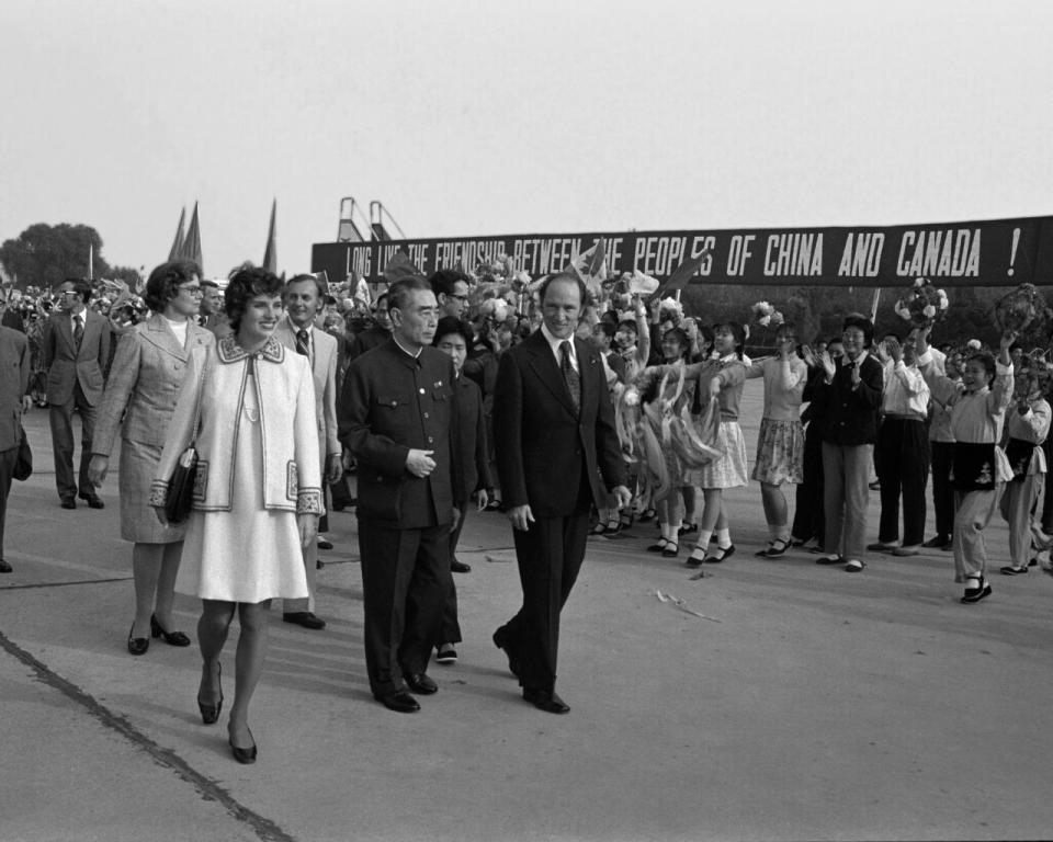 Former prime minister Pierre Trudeau and wife Margaret walk next to former Chinese premier Zhou Enlai on arrival in Beijing, China, on Oct. 10, 1973. THE CANADIAN PRESS/PETER BREGG