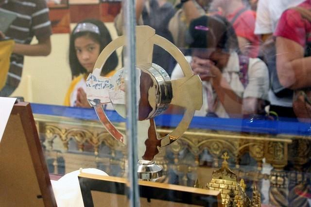 A Filipino Catholic devotee prays at the relics of the Blessed John Paul II that are displayed at the Activity Area of the Gateway Mall in Quezon City. From October 9-21, the relics and photo exhibit of newly Blessed Pope John Paul II will be displayed for public viewing by Araneta Center and Diocese of Cubao in celebration of the upcoming first feast day of the newly Blessed Pope John Paul II which falls on October 22. (Jhun Dantes Jr/NPPA Images)