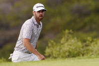 Matthew Wolff walks off the 13th green during the second round of the U.S. Open Golf Championship, Friday, June 18, 2021, at Torrey Pines Golf Course in San Diego. (AP Photo/Jae C. Hong)