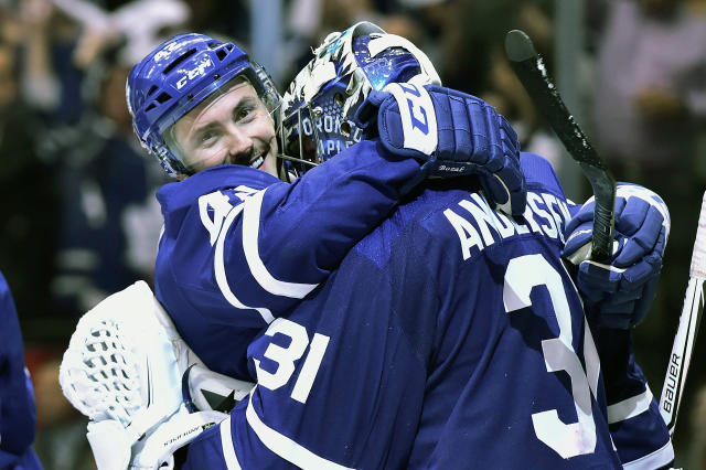 Toronto Maple Leafs centre Tyler Bozak (42) and goaltender Frederik Andersen (31) celebrate their win over the Boston Bruins in NHL round one playoff hockey action in Toronto on Monday, April 23, 2018. (Frank Gunn/The Canadian Press via AP)