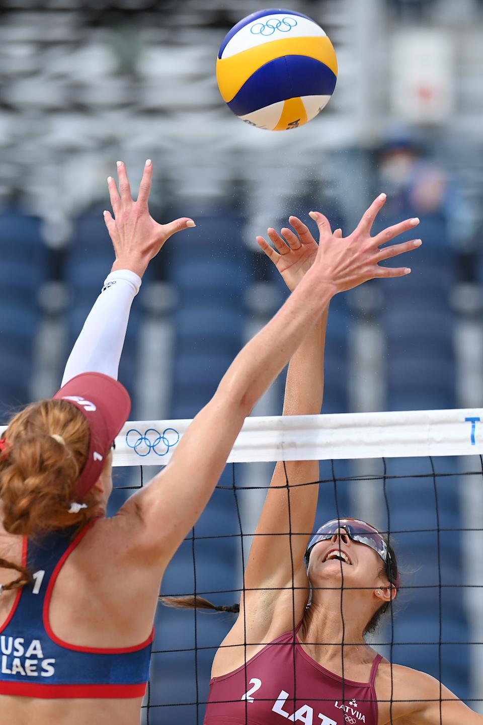 <p>Anastasija Kravcenoka #2 of Team Latvia attempts to hit over Kelly Claes #1 of Team United States during the Women's Preliminary - Pool D beach volleyball on day three of the Tokyo 2020 Olympic Games at Shiokaze Park on July 26, 2021 in Tokyo, Japan. (Photo by Matthias Hangst/Getty Images)</p>