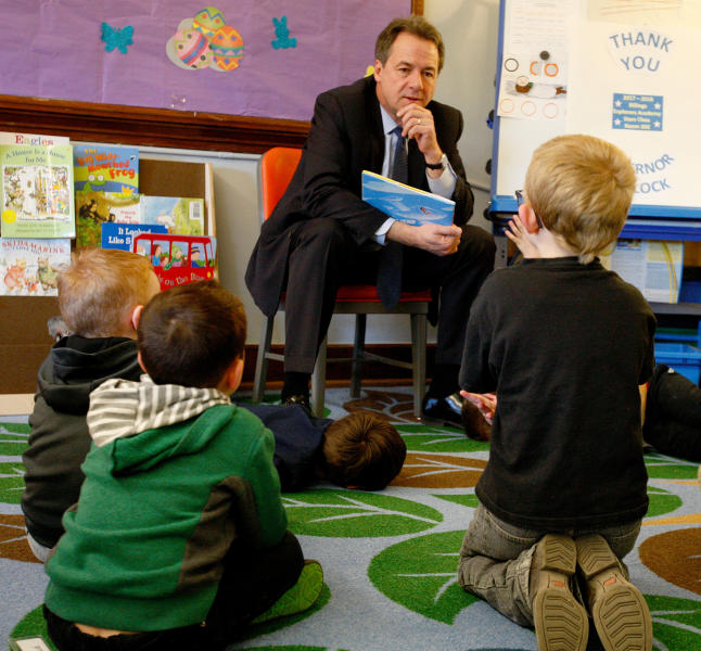 File - In this March 27, 2018, file photo, Gov. Steve Bullock talks with kids in a publicly funded preschool class in Billings, Mont.  Education interests helped defeat a proposal to continue funding both public and private preschools over the next two school years. Early childhood education was one of Bullock's top priorities. (Casey Page/The Billings Gazette via AP, File)