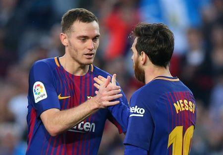 FILE PHOTO: Soccer Football - La Liga Santander - FC Barcelona v Villarreal - Camp Nou, Barcelona, Spain - May 9, 2018 Barcelona's Lionel Messi celebrates with Thomas Vermaelen after scoring their third goal REUTERS/Albert Gea