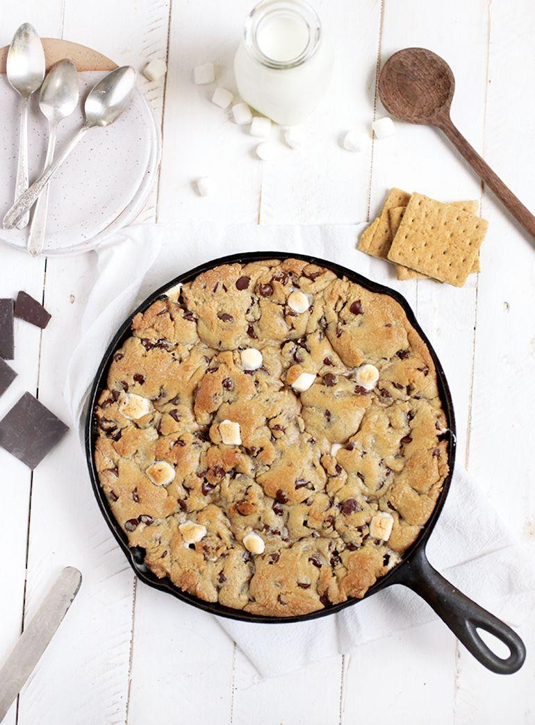 """<p>Consider this warm, soft peanut butter-filled cookie the ultimate companion for your next Netflix binge. </p><p><a href=""""https://themerrythought.com/recipes/peanut-butter-smores-skillet-cookie/"""" rel=""""nofollow noopener"""" target=""""_blank"""" data-ylk=""""slk:Get the recipe"""" class=""""link rapid-noclick-resp"""">Get the recipe</a>.</p>"""