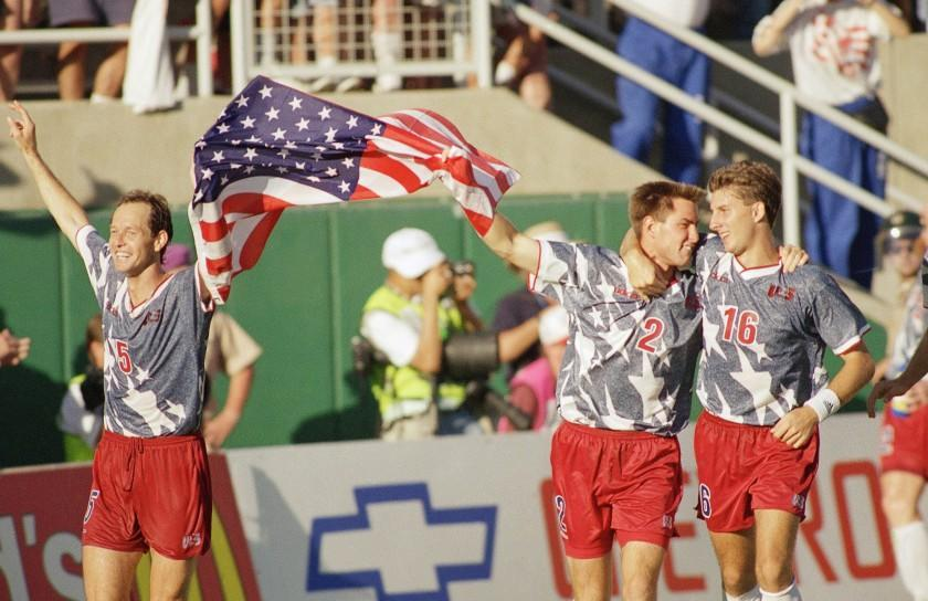 United States players Thomas Dooley, left, Mike Lapper, middle, and Mike Sorber celebrate their 2-1 upset victory over the Colombian team during the World Cup soccer championship Group A first round match at the Rose Bowl in Pasadena, Calif., June 22, 1994. (AP Photo/Lois Bernstein)