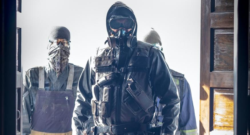 Pandemic survivors in hazmat suits survey the damage wrought by the Captain Trips virus in 'The Stand' (Photo: CBS/CBS Interactive)