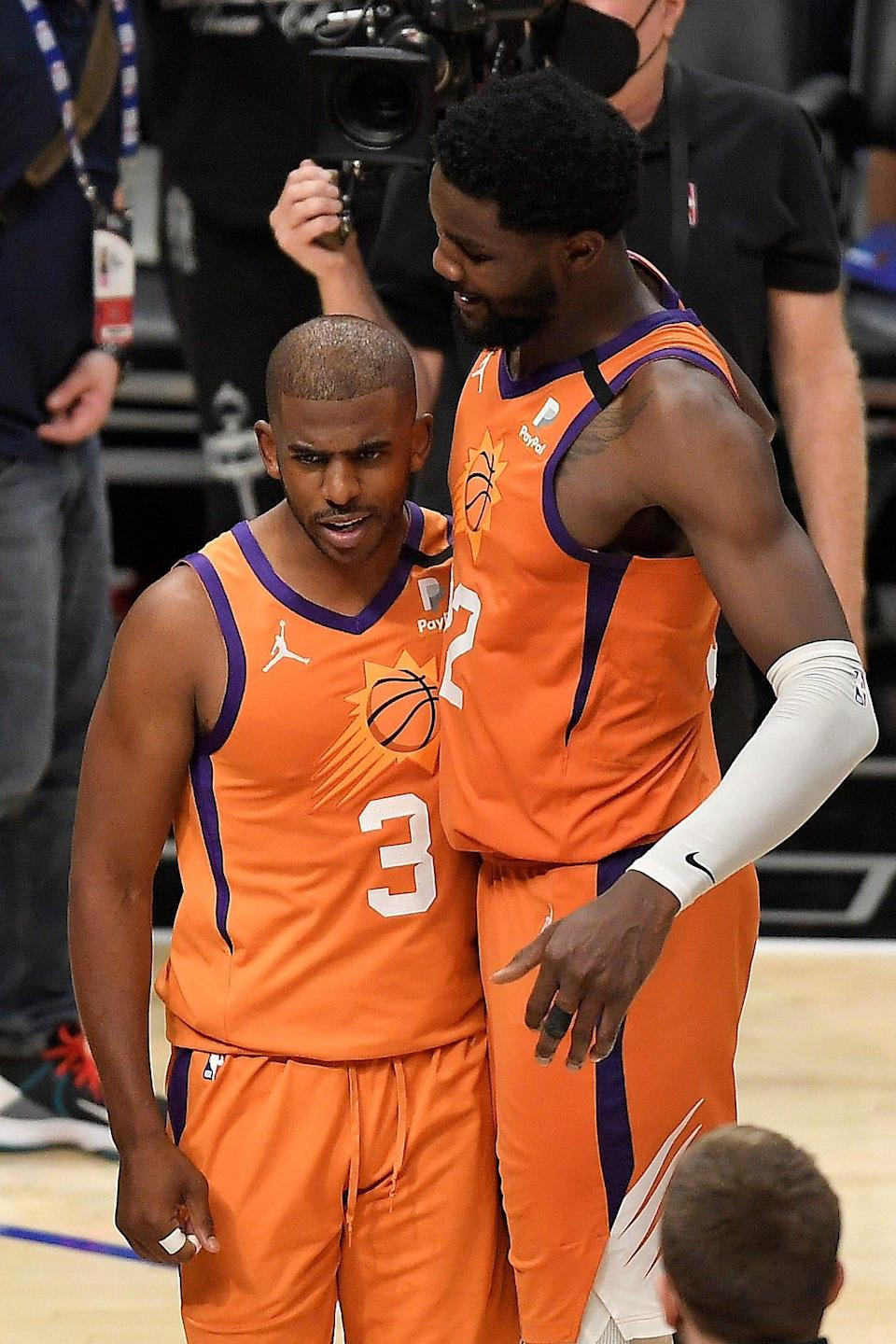 """Deandre Ayton (right) called Chris Paul's presence """"the best thing that happened in my career."""""""