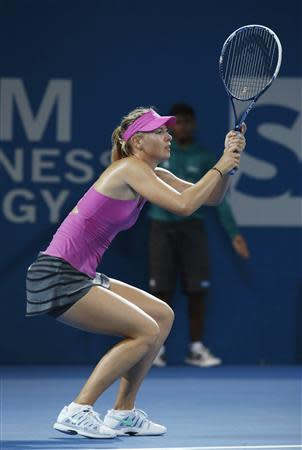 Sharapova of Russia reacts to lost point during women's singles semi-final loss to Williams of U.S. at Brisbane International tennis tournament in Brisbane