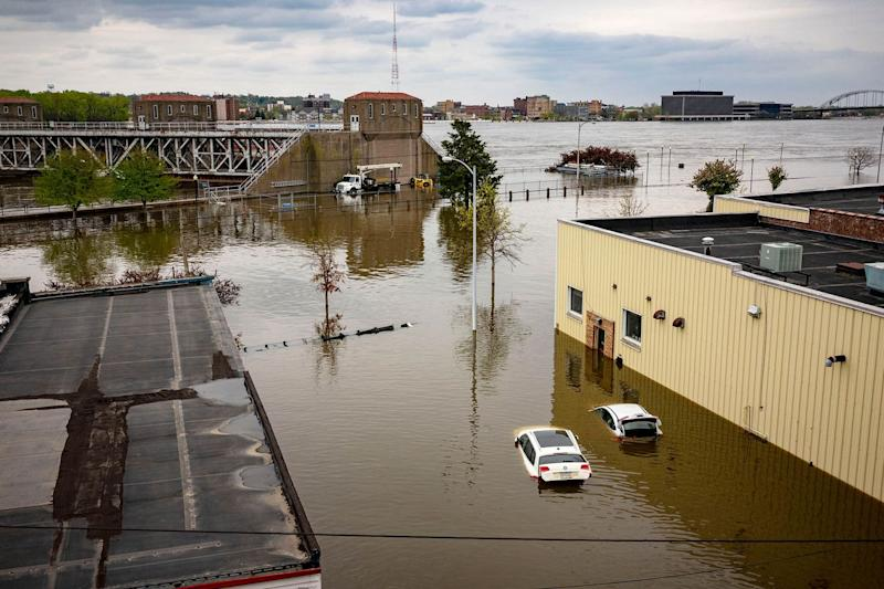 <p>Flood waters surround area businesses near the main breach in the Mississippi River in Davenport, Iowa on Friday, May 3, 2019.</p>