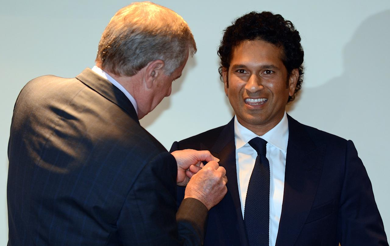"Simon Crean (L), Australian Minister for Regional Australia, Regional Development and Local Government, presents the membership of The Order of Australia to Indian cricketer Tendulkar in Mumbai on November 6, 2012. India's record-breaking batsman Sachin Tendulkar on November 6 was conferred with membership of the Order of Australia. Australian Prime Minister Julia Gillard, who announced Tendulkar's membership to the Order during a three-day state visit to India last month, told reporters that Tendulkar deserved the ""special honour"" because he was a ""very special cricketer"". AFP PHOTO/ INDRANIL MUKHERJEE"