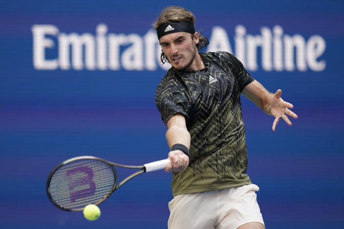 Stefanos Tsitsipas, of Greece, returns a shot to Andy Murray, of Great Britain, during the first round of the US Open tennis championships, Monday, Aug. 30, 2021, in New York. (AP Photo/Seth Wenig)