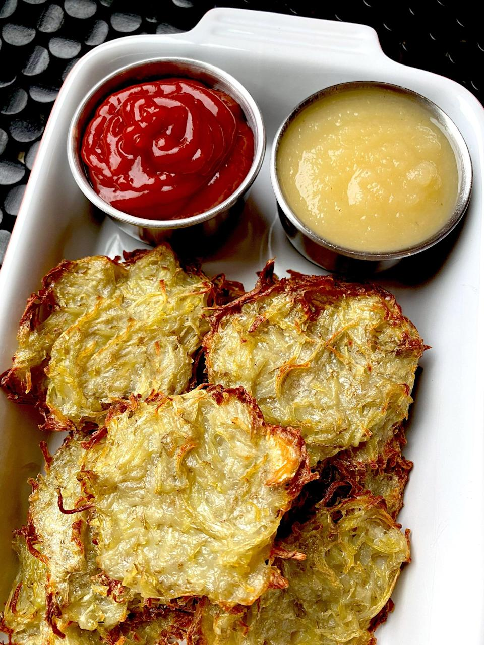 """<p>While the whole point of eating potato latkes to celebrate Hanukkah is that they're fried in oil - to symbolize how the oil burned for eight days - there's a healthier option! </p> <p><strong>Get the recipe:</strong> <a href=""""https://www.popsugar.com/fitness/easy-air-fryer-potato-latke-recipe-48048309"""" class=""""link rapid-noclick-resp"""" rel=""""nofollow noopener"""" target=""""_blank"""" data-ylk=""""slk:air-fryer potato latkes"""">air-fryer potato latkes</a></p>"""
