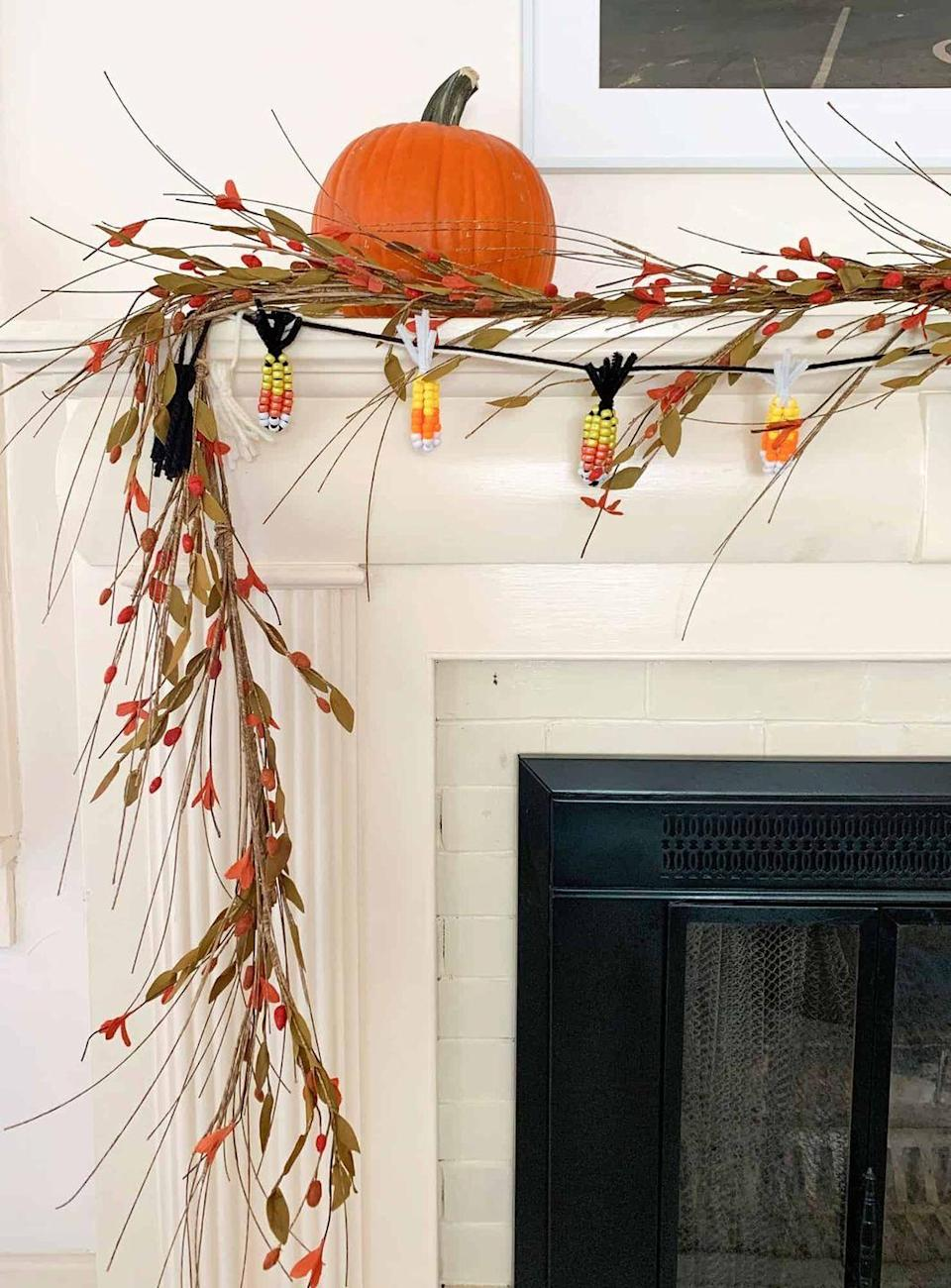 """<p>Yum—candy corn! Except this time, your favorite fall treat is dressing up a garland for your fireplace. </p><p><strong>Get the tutorial at <a href=""""https://abeautifulmess.com/diy-candy-corn-garland/"""" rel=""""nofollow noopener"""" target=""""_blank"""" data-ylk=""""slk:A Beautiful Mess"""" class=""""link rapid-noclick-resp"""">A Beautiful Mess</a>.</strong></p><p><a class=""""link rapid-noclick-resp"""" href=""""https://go.redirectingat.com?id=74968X1596630&url=https%3A%2F%2Fwww.walmart.com%2Fip%2F500-Pack-Black-Pipe-Cleaners-Craft-Fuzzy-Sticks-Chenille-Stems-for-Art-Creative-DIY-Kids-Creativity-Decoration-6-mm-x-12-Inch%2F679423008&sref=https%3A%2F%2Fwww.thepioneerwoman.com%2Fhome-lifestyle%2Fcrafts-diy%2Fg36891743%2Ffall-mantel-decorations%2F"""" rel=""""nofollow noopener"""" target=""""_blank"""" data-ylk=""""slk:SHOP PIPE CLEANERS"""">SHOP PIPE CLEANERS</a></p>"""