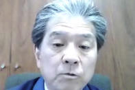 In this image from video released by TEPCO, Akira Ono, chief decommissioning officer of the Fukushima Dai-ichi nuclear power plant, speaks during a video interview in Tokyo Tuesday, March 2, 2021. The head of the wrecked Fukushima nuclear plant said Tuesday there's no need to extend the current target to finish its decommissioning in 30-40 years despite uncertainties about melted fuel inside the plant's three reactors. (TEPCO via AP)