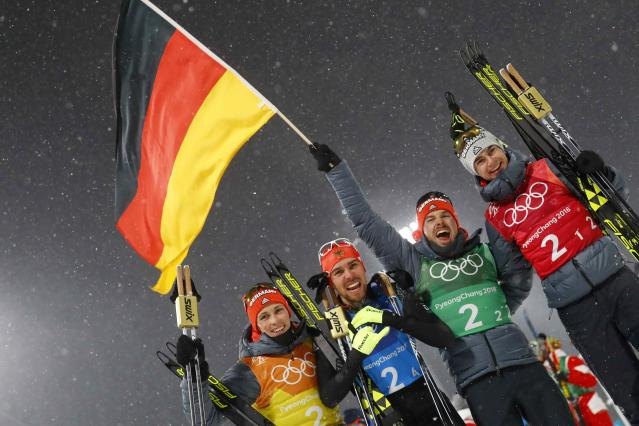Nordic Combined Events - Pyeongchang 2018 Winter Olympics - Men's Team 4 x 5 km Final - Alpensia Cross-Country Skiing Centre - Pyeongchang, South Korea - February 22, 2018 - Johannes Rydzek of Germany celebrates winning the gold medal with teammates Vinzenz Geiger, Fabian Riessle and Eric Frenzel. REUTERS/Kai Pfaffenbach