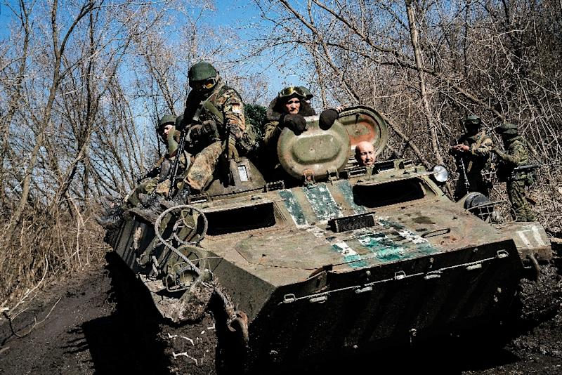 Armed pro-Russian rebels sit on top of an armoured personnel carrier as they take part in a military drill near the eastern Ukrainian city of Donetsk on April 10, 2015