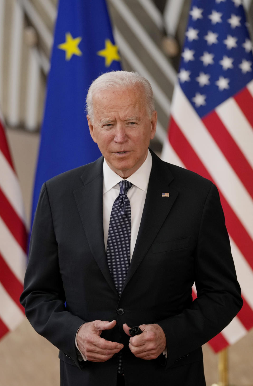 U.S. President Joe Biden speaks with the media as he arrives for the EU-US summit at the European Council building in Brussels, Tuesday, June 15, 2021. (AP Photo/Francisco Seco)