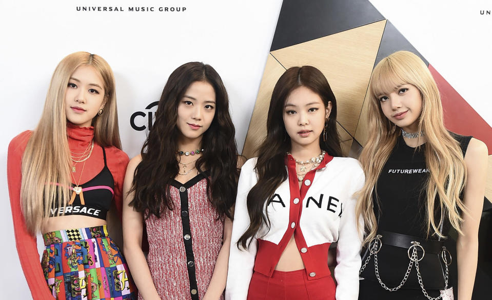 """This image released by Universal Music Group shows members of Blackpink at Sir Lucian Grainge's 2019 Artist Showcase Presented by Citi in Los Angeles on Feb. 9, 2019. The band releases their new album """"The Album"""" on Friday. (Jordan Strauss/Invision for Universal Music Group via AP)"""