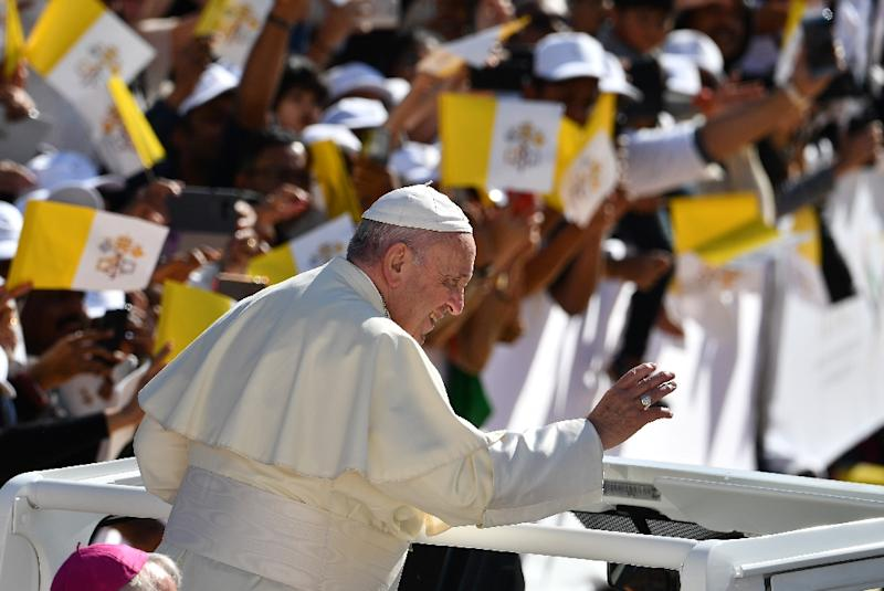 Pope Francis -- has paid particular attention to migrants and refugees during his papacy and he United Arab Emirates hosts around one million Catholics, mainly Filipinos and Indians among its large migrant workforce (AFP Photo/Vincenzo PINTO                      )