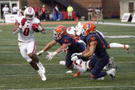 Wisconsin running back Braelon Allen (0) eludes Illinois linebacker Jake Hansen (35) and Sydney Brown (30) during the first half of an NCAA college football game Saturday, Oct. 9, 2021, in Champaign, Ill. (AP Photo/Charles Rex Arbogast)