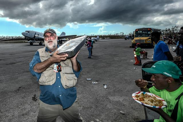 "<div class=""caption""> Chef Jose Andres delivers food from World Central Kitchen at Treasure Cay International Airport. </div> <cite class=""credit"">Dom Furore</cite>"