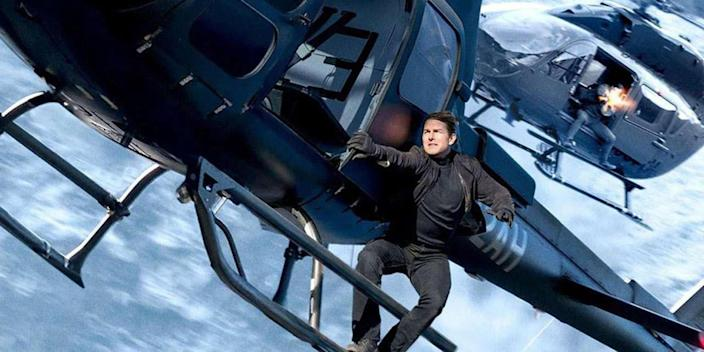 """Tom Cruise hangs from a helicopter in a climactic action sequence in """"Mission: Impossible – Fallout."""" <span class=""""copyright"""">(Paramount Pictures)</span>"""