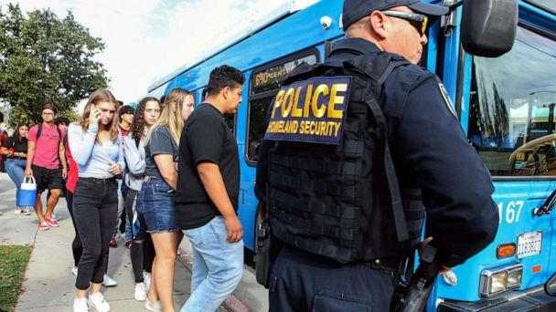 PHOTO: Students are evacuated from Saugus High School onto a bus after a shooting at the school left two students dead and three wounded on Nov. 14, 2019, in Santa Clarita, Calif. (Mario Tama/Getty Images)