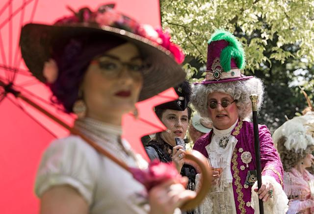 "<p>Participants of the so called ""Victorian Picnic"" relax in fancy costumes during the Wave Gothic Festival (WGT) in Leipzig, Germany, Friday, June 2, 2017. (AP Photo/Jens Meyer) </p>"