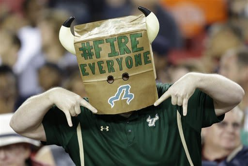 A disgruntled South Florida fan shows his displeasure during the first quarter of an NCAA college football game against Pittsburgh Saturday, Dec. 1, 2012, in Tampa, Fla. (AP Photo/Chris O'Meara)