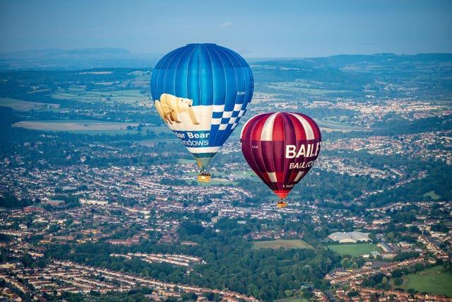 Balloons slowly floated over north Bristol (Ben Birchall/PA)