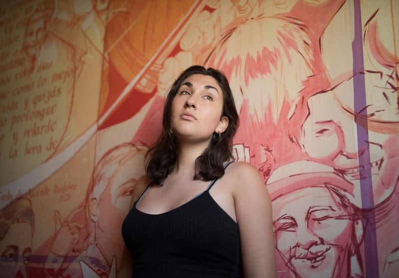 Chilean Emilia Schneider, a transgender woman, student and political activist, poses for a photograph, in Santiago