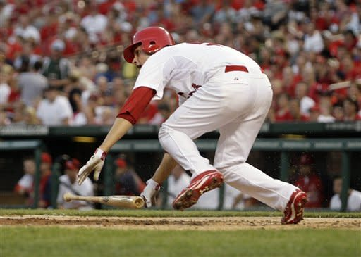 St. Louis Cardinals starting pitcher Joe Kelly stumble out of the batters box after hitting the ball in the second inning of a baseball game against the Los Angeles Dodgers, Monday, July 23, 2012 in St. Louis. Kelly grounded out to third on the play.(AP Photo/Tom Gannam)